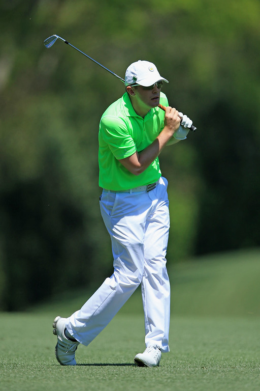 . Garrick Porteous of England watches his approach shot on the fifth hole during the first round of the 2014 Masters Tournament at Augusta National Golf Club on April 10, 2014 in Augusta, Georgia.  (Photo by David Cannon/Getty Images)