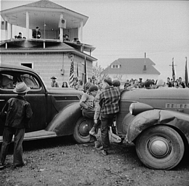 . Ashland, Aroostook County, Maine. Even with gasoline rationed, many people attended the Memorial Day ceremonies in cars, 1943. John Collier, Photographer.  Courtesy the Library of Congress
