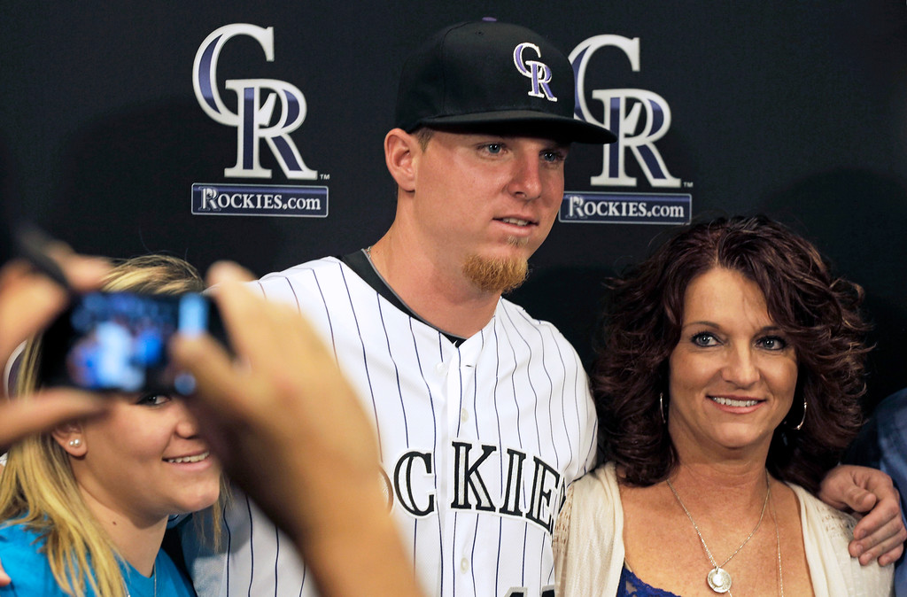 . Colorado Rockies first-round draft pick Jonathan Gray, center, poses for photos with his mother Sarah McCollough at a baseball news conference where the team announced they had agreed to terms on Wednesday, June 12, 2013 in Denver. Gray, a right-handed pitcher, was the third-overall pick in the 2013 First-Year Player Draft. (AP Photo/Joe Mahoney)