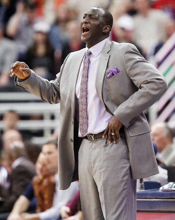 . Utah Jazz head coach Tyrone Corbin shouts to his team in the second quarter during an NBA basketball game against the Denver Nuggets, Monday, Jan. 13, 2014, in Salt Lake City. (AP Photo/Rick Bowmer)