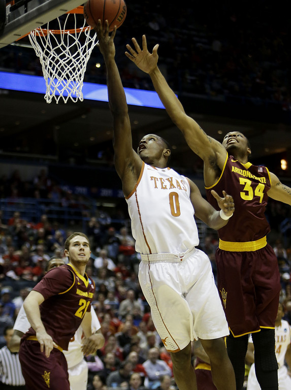 . Kendal Yancy #0 of the Texas Longhorns shoots against Jermaine Marshall #34 of the Arizona State Sun Devils in the first half during the second round of the 2014 NCAA Men\'s Basketball Tournament at BMO Harris Bradley Center on March 20, 2014 in Milwaukee, Wisconsin.  (Photo by Mike McGinnis/Getty Images)