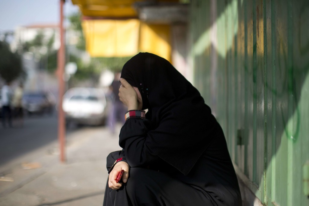 """. A Palestinian woman who lost a relative in an Israeli strike on a compound housing a UN school in Jabalia refugee camp in the northern Gaza Strip, mourns outside the Kamal Edwin hospital in Beit Lahia where victims from the attack were brought early on July 30, 2014. Israeli bombardments early on July 30 killed \""""dozens\"""" Palestinians in Gaza, including at least 16 at a UN school, medics said, on day 23 of the Israel-Hamas conflict. AFP PHOTO / MAHMUD HAMS/AFP/Getty Images"""