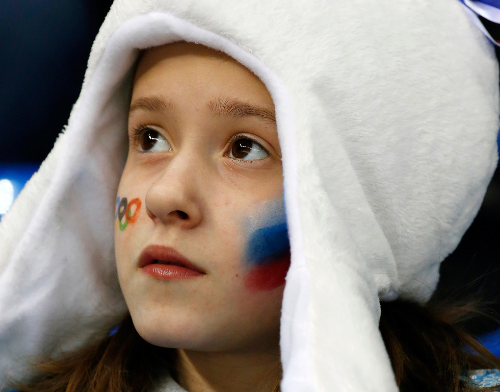 . A young Russian hockey fans watches the women\'s game between Russia and Germany at Shayba Arena during the 2014 Winter Olympics, Sunday, Feb. 9, 2014, in Sochi, Russia. (AP Photo/Julio Cortez)