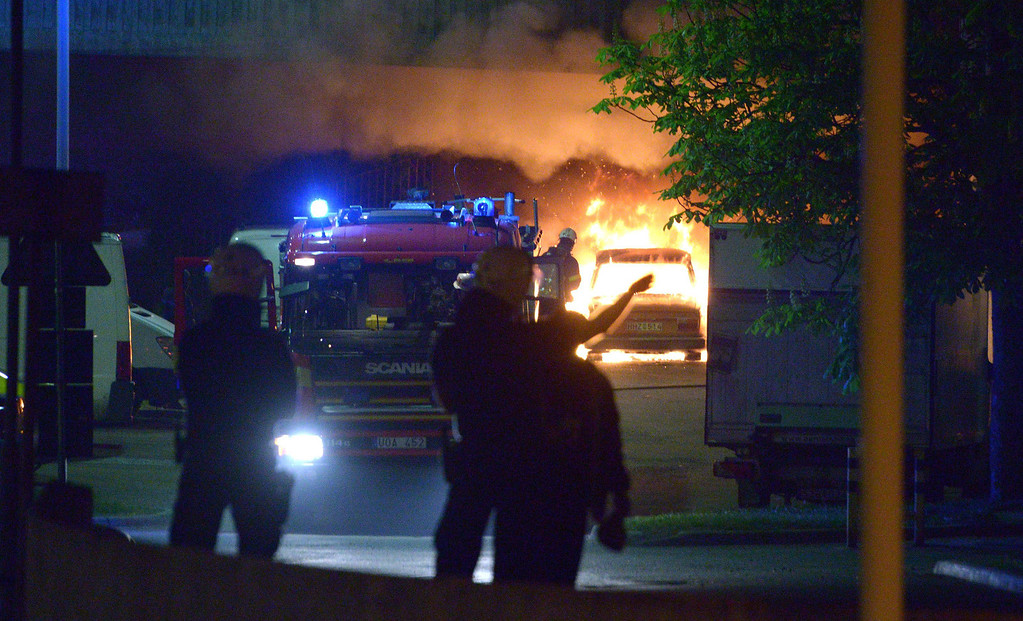 . Police faces youths rioting in northern Stockholm on Sunday night and early morning Monday on May 20, 2013, setting fire to cars and throwing rocks at police, in what is believed to be a protest against the fatal police shooting of a machete-wielding man in the suburb last week. JOHAN NILSSON/AFP/Getty Images