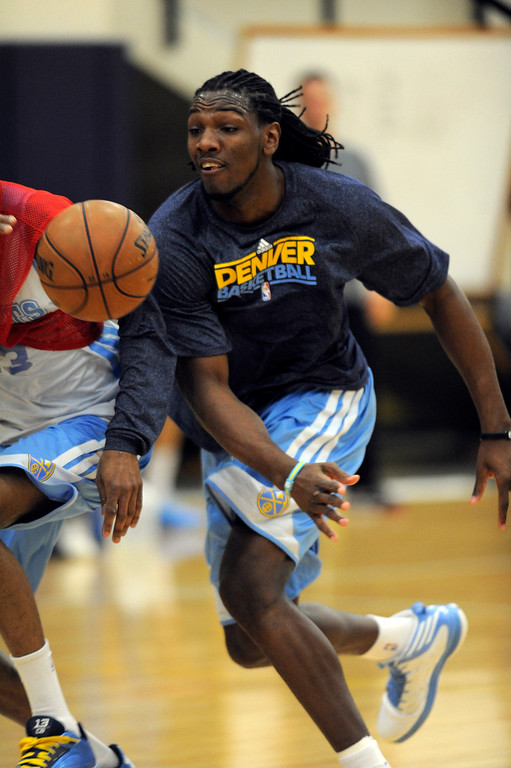 . Kenneth Faried (35) of the Denver Nuggets knocks the ball away  during practice April 22, 2013 at Pepsi Center. The Denver Nuggets prepare for game two of the first round of the NBA playoffs against the Golden State Warriors. (Photo By John Leyba/The Denver Post)