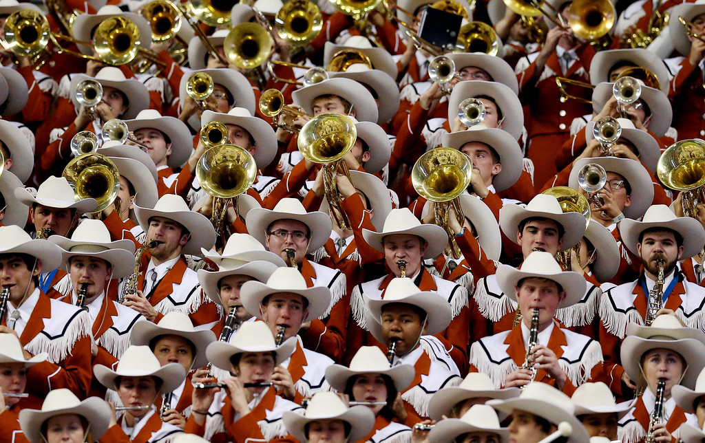 . The Texas Longhorns band performs during the Valero Alamo Bowl against the Oregon Ducks at the Alamodome on December 30, 2013 in San Antonio, Texas.  (Photo by Ronald Martinez/Getty Images)