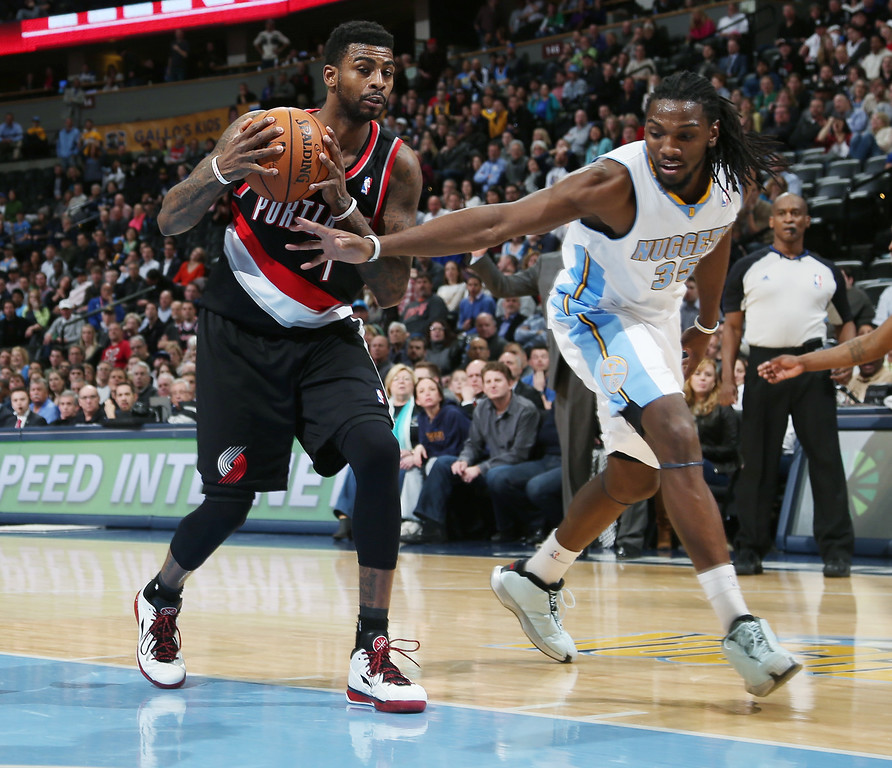 . Portland Trail Blazers forward Dorell Wright, left, pulls in a loose ball as Denver Nuggets forward Kenneth Faried covers in the fourth quarter of an NBA basketball game in Denver, Tuesday, Feb. 25, 2014. Portland won 100-95. (AP Photo/David Zalubowski)