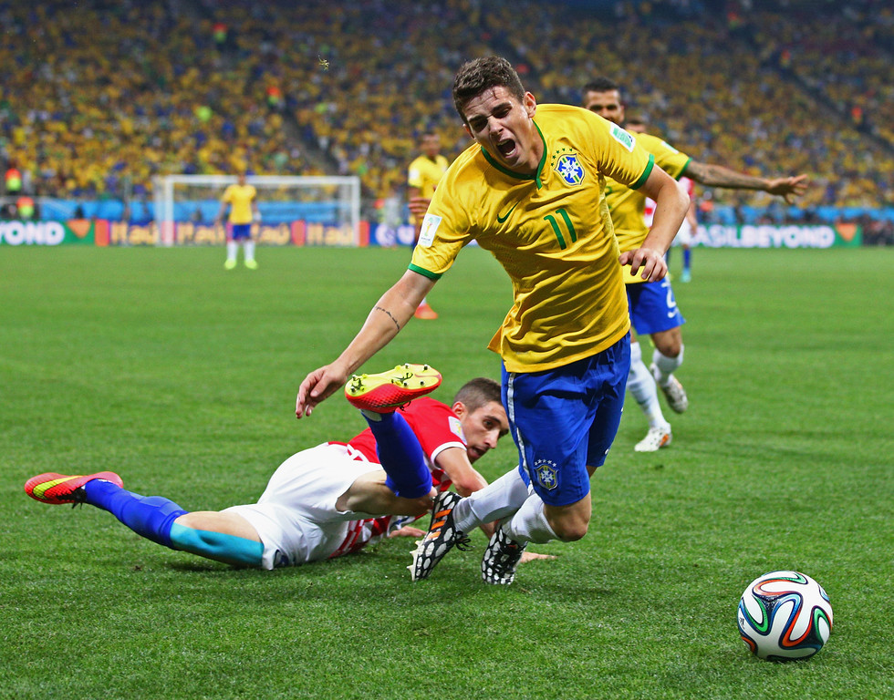 . Oscar of Brazil is tripped up by Sime Vrsaljko of Croatia in the second half during the 2014 FIFA World Cup Brazil Group A match between Brazil and Croatia at Arena de Sao Paulo on June 12, 2014 in Sao Paulo, Brazil.  (Photo by Adam Pretty/Getty Images)