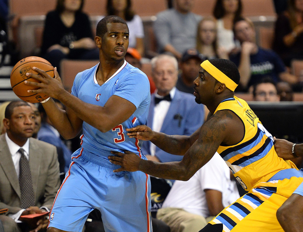 . Chris Paul #3 of the Los Angeles Clippers looks to pass around Ty Lawson #3 of the Denver Nuggets during their preseason game at the Mandalay Bay Events Center on October 19, 2013 in Las Vegas, Nevada. Los Angeles won 118-111 in overtime.    (Photo by Ethan Miller/Getty Images)