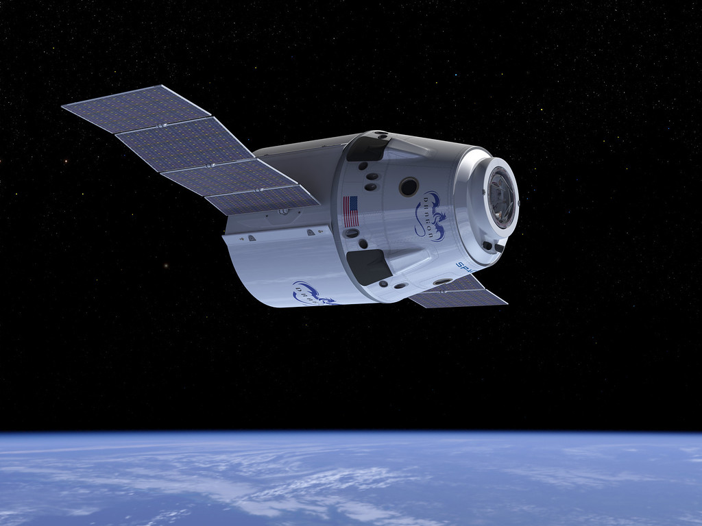 . This undated computer generated illustration provided by SpaceX shows a Dragon Crew spacecraft in Earth orbit showing solar panels in the process of deploying. NASA has picked three aerospace companies to build small rocketships to take astronauts to the International Space Station. This is the third phase of NASA\'s efforts to get private space companies to take over the job of the now-retired space shuttle. The space agency is giving them more than $1.1 billion. Two of three ships are capsules like in the Apollo era and the third is a lifting body that is closer in design to the space shuttle. (AP Photo/SpaceX)