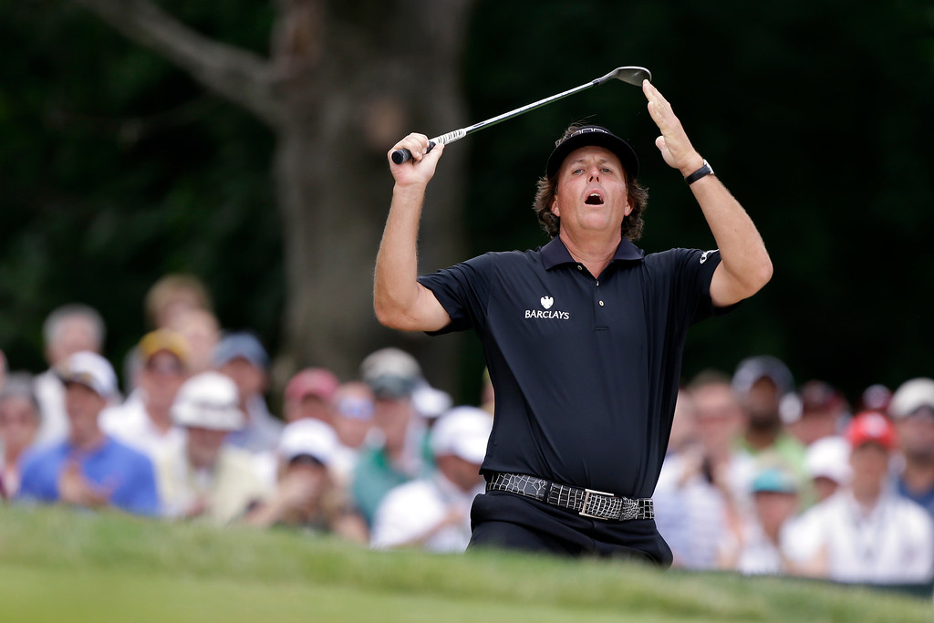 . Phil Mickelson reacts to his shot from the bunker on the second hole during the fourth round of the U.S. Open golf tournament at Merion Golf Club, Sunday, June 16, 2013, in Ardmore, Pa. (AP Photo/Darron Cummings)