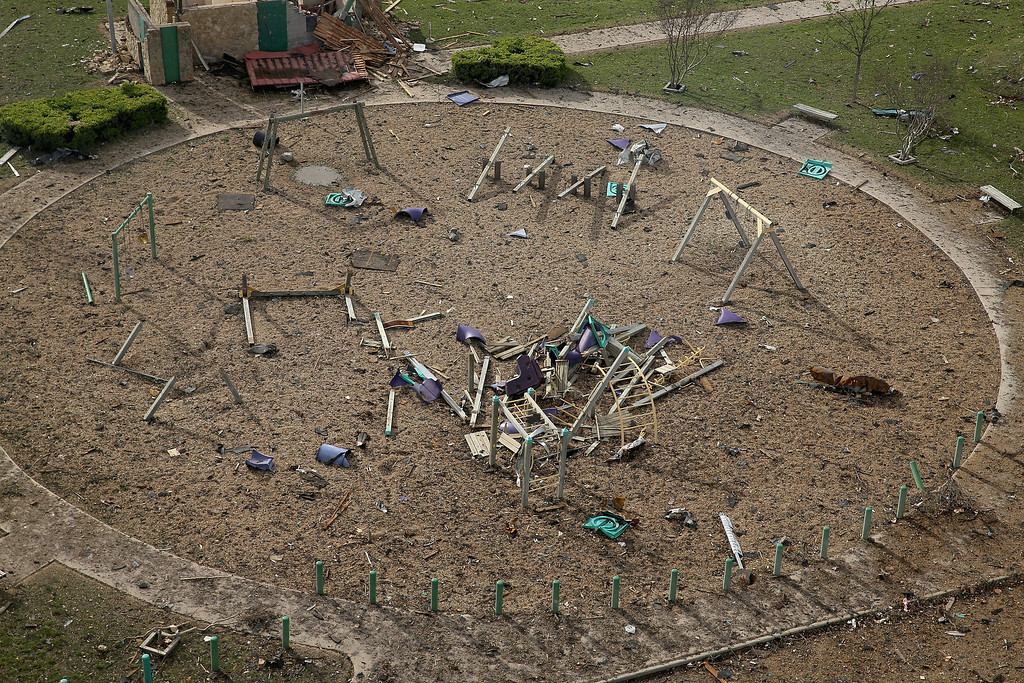 . WEST, TX - APRIL 18:  An explosion yesterday at the West Fertilizer Company destroyed this playground across the street, shown from the air on April 18, 2013 in West, Texas. According to West Mayor Tommy Muska, around 14 people, including 10 first responders, were killed and more than 150 people were injured when the fertilizer company caught fire and exploded, leaving damaged buildings for blocks in every direction.  (Photo by Chip Somodevilla/Getty Images)