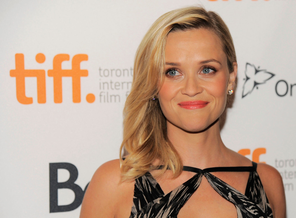 """. Reese Witherspoon, a cast member in \""""Devil\'s Knot,\"""" poses at the premiere of the film on day 4 of the 2013 Toronto International Film Festival in the Visa Screening Room at the Elgin Theatre on Sunday, Sept. 8, 2013 in Toronto. (Photo by Chris Pizzello/Invision/AP)"""