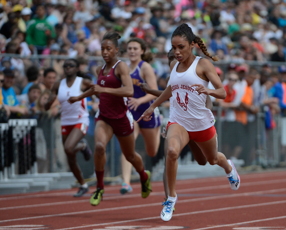 . LAKEWOOD, CO - MAY 18:  Ana Holland, Regis Jesuit, right, crosses the finish line first  to win the girls 5A 100 meter race at the Colorado State Track and Field Championships at Jeffco Stadium, Saturday morning, May 18, 2013. Holland won with a time of 11.33, a new meet record. (Photo By Andy Cross/The Denver Post)