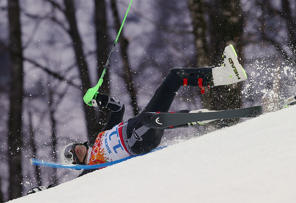 . Mexico\'s Hubertus von Hohenlohe crashes during the first run of the men\'s slalom at the Sochi 2014 Winter Olympics, Saturday, Feb. 22, 2014, in Krasnaya Polyana, Russia. (AP Photo/Alessandro Trovati)