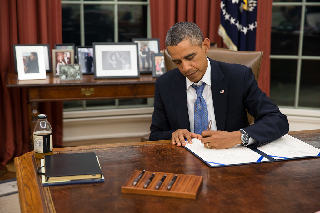 . In this handout photo provided by The White House, U.S. President Barack Obama signs H.R. 3210, Pay Our Military Act, which provides continuing appropriations for pay and allowances for members of the Armed Forces during any period for which interim or full-year appropriations for FY 2014 are not in effect, in the Oval Office on September 30, 2013 in Washington, DC.   (Photo by Pete Souza/The White House via Getty Images)