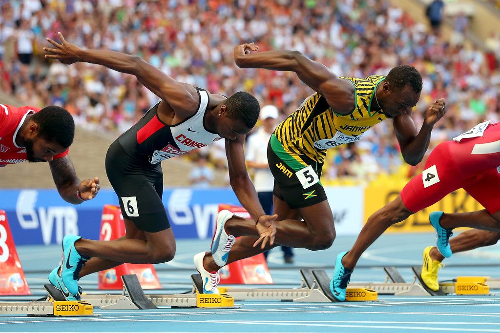. (L-R) Aaron Brown of Canada and Usain Bolt of Jamaica leaves the blocks in the Men\'s 100 metres semi final during Day Two of the 14th IAAF World Athletics Championships Moscow 2013 at Luzhniki Stadium on August 11, 2013 in Moscow, Russia.  (Photo by Mark Kolbe/Getty Images)