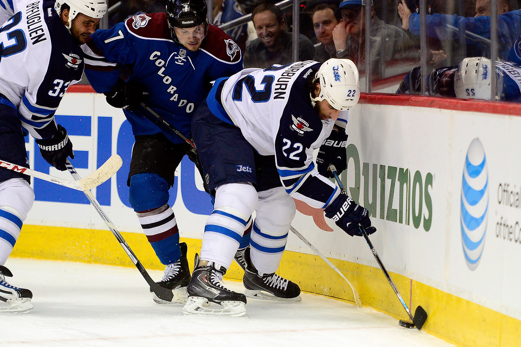 . Chris Thorburn (22) of the Winnipeg Jets controls the puck as teammate Dustin Byfuglien (33) defends John Mitchell (7) of the Colorado Avalanche during the first period of action.  (Photo by AAron Ontiveroz/The Denver Post)