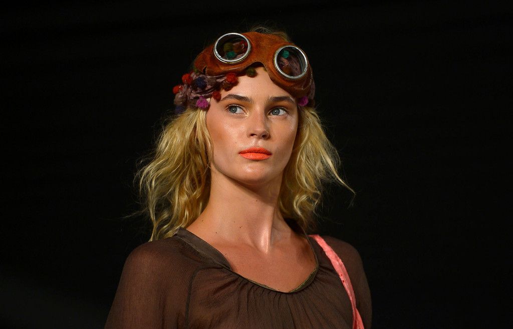 . A model wears a creation from TCN during a 080 Barcelona fashion show in Barcelona, Spain, Wednesday, July 10, 2013.  (AP Photo/Manu Fernandez)