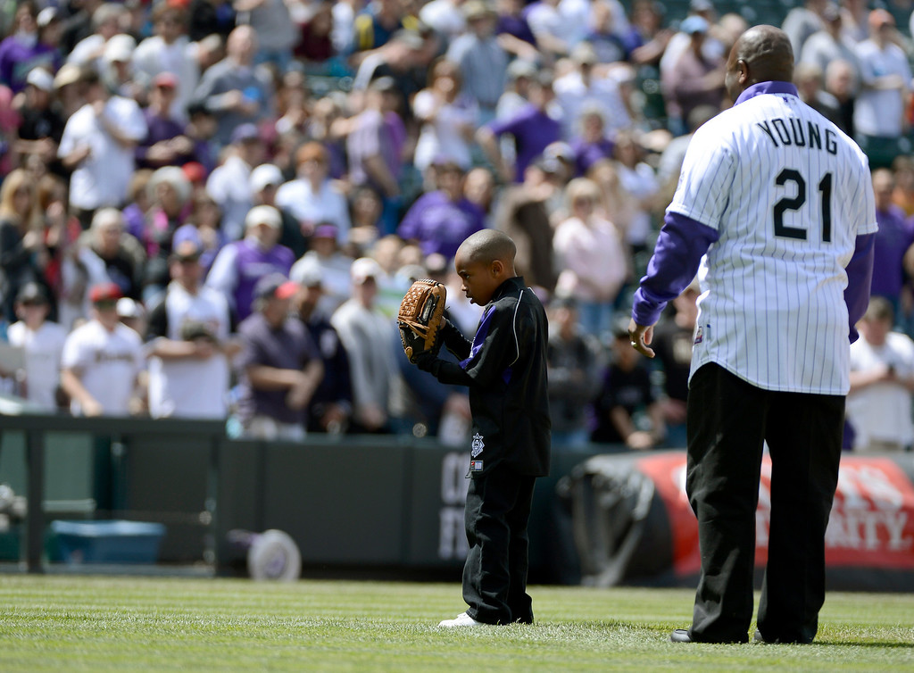 . DENVER, CO. - APRIL 21: Colorado Rockies retired player Eric Young stands with his son Dallas Young 6-years-old as he prepares to throw out the first pitch to his older brother Eric Young Jr. prior to their game against the Arizona DiamondBacks April 21, 2013 at Coors Field. (Photo By John Leyba/The Denver Post)