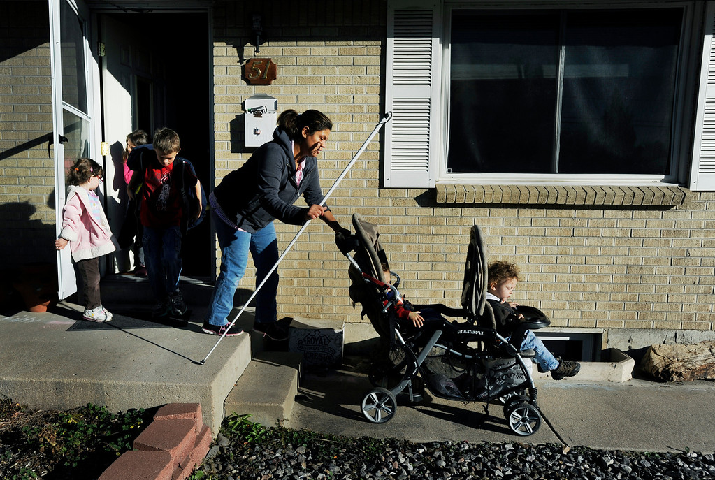 . Ena Batron, center, leaves the house with her five children for the family\'s daily routines. Ena and Brent Batron are both blind, and raising five kids under the age of 10.  Photo by Jamie Cotten, Special to The Denver Post