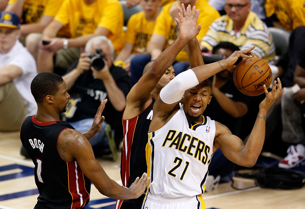 . INDIANAPOLIS, IN - MAY 28:  David West #21 of the Indiana Pacers looks to pass as Chris Bosh #1 and Shane Battier #31 of the Miami Heat defend during Game Five of the Eastern Conference Finals of the 2014 NBA Playoffs at Bankers Life Fieldhouse on May 28, 2014 in Indianapolis, Indiana.  (Photo by Joe Robbins/Getty Images)
