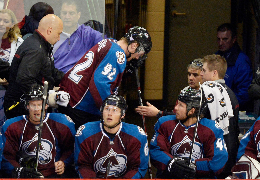 . Colorado Avalanche left wing Gabriel Landeskog (92) is helped off the bench and in to the locker room as he left the game in the third period October 17, 2013 at Pepsi Center.(Photo by John Leyba/The Denver Post)