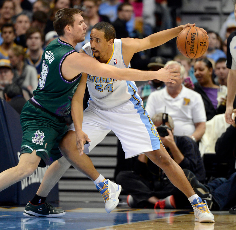 . DENVER, CO. - FEBRUARY 05: Beno Udrih (19) of the Milwaukee Bucks reahces in on Andre Miller (24) of the Denver Nuggets during the third quarter February 05, 2013 at Pepsi Center. The Denver Nuggets take on the Milwaukee Bucks in NBA action. (Photo By John Leyba/The Denver Post)