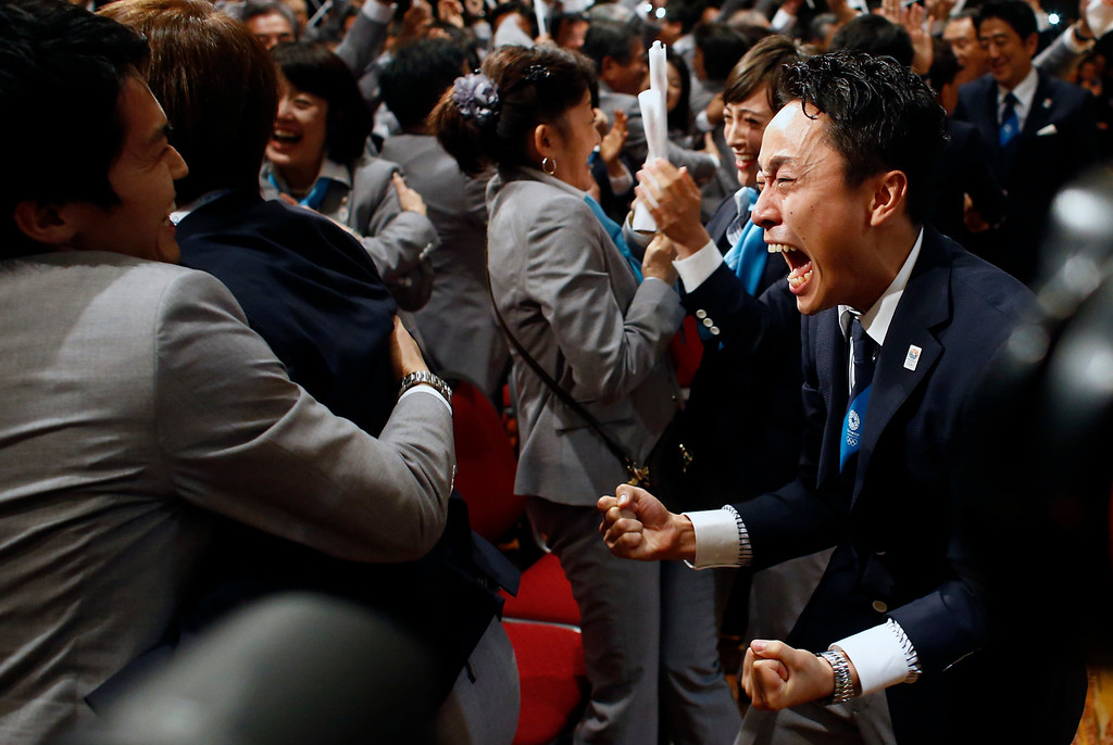 . Members of the Tokyo 2020 delegation celebrate after Tokyo was awarded the 2020 Olympic Games during the 125th IOC session in Buenos Aires, Argentina,  Saturday, Sept. 7, 2013.  (AP Photo/Victor R. Caivano, File)