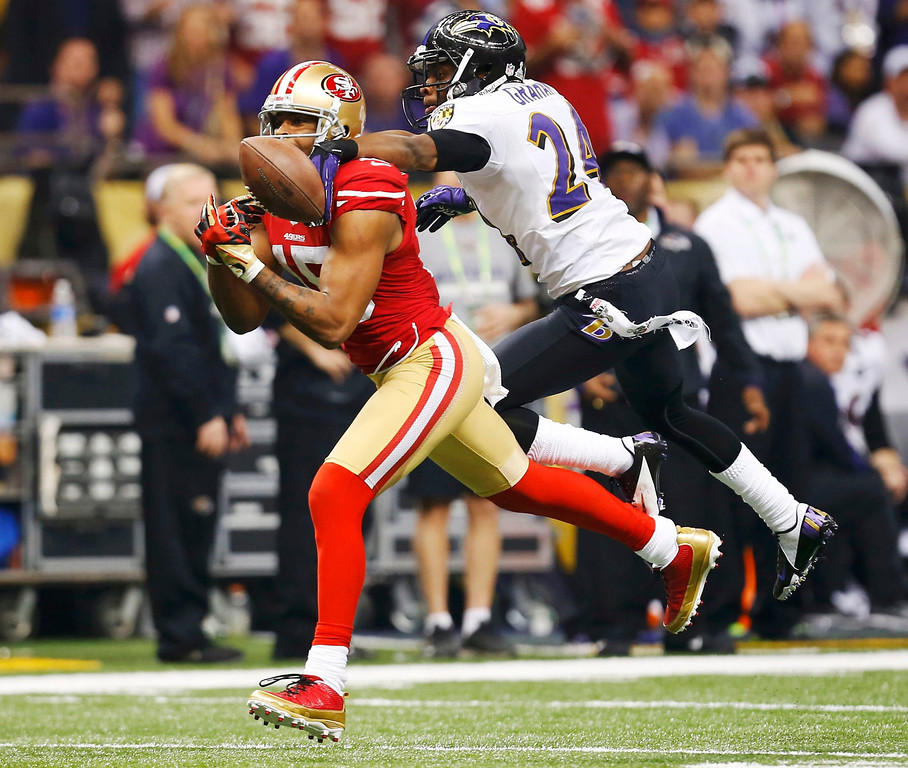 . Baltimore Ravens cornerback Corey Graham breaks up a pass intended for San Francisco 49ers wide receiver Michael Crabtree (R) during the third quarter in the NFL Super Bowl XLVII football game in New Orleans, Louisiana, February 3, 2013.   REUTERS/Jeff Haynes