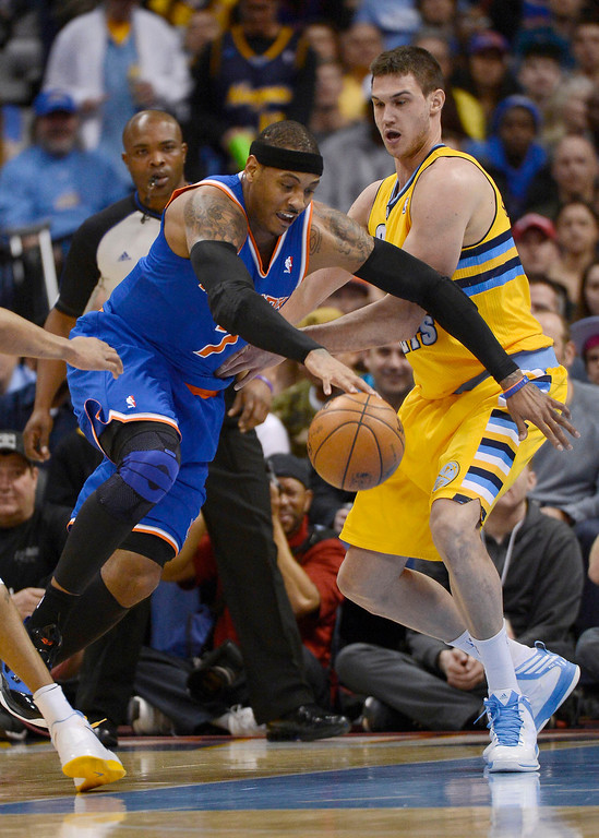 . Carmelo Anthony (7) of the New York Knicks works his way around Danilo Gallinari (8) of the Denver Nuggetsm during the first quarter March 13, 2013 at Pepsi Center. (Photo By John Leyba/The Denver Post)