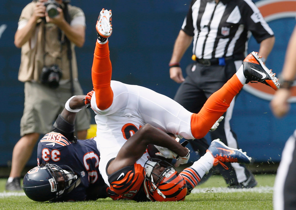 . Cincinnati Bengals wide receiver A.J. Green, right, makes a reception against Chicago Bears cornerback Charles Tillman (33) during the first half of an NFL football game, Sunday, Sept. 8, 2013, in Chicago. (AP Photo/Charles Rex Arbogast)