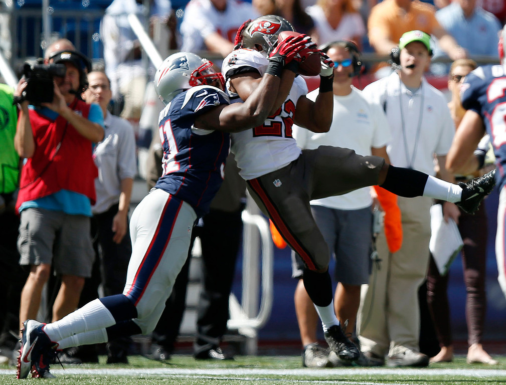 . Tampa Bay Buccaneers running back Doug Martin (22) catches a pass in front of New England Patriots outside linebacker Jerod Mayo (51) in the first half of an NFL football game Sunday, Sept. 22, 2013, in Foxborough, Mass. (AP Photo/Elise Amendola)