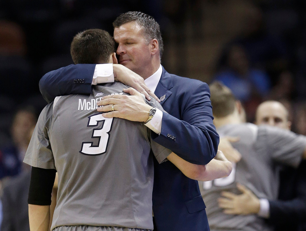 . Creighton head coach Greg McDermott hugs his son Doug McDermott (3) as he leaves the game during the final moments in the second half of a third-round game against Baylor in the NCAA college basketball tournament Sunday, March 23, 2014, in San Antonio. Baylor won 85-55.(AP Photo/David J. Phillip)