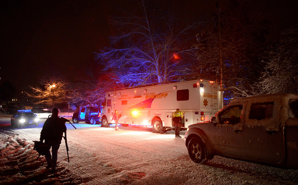 . Law enforcement lines the street near the scene of a shooting in the 500 block of Fox Hunt Circle in Highlands Ranch, Colorado, Friday, January 31, 2014. Officials on the scene confirmed two fatalities in the incident, which was reported around 7:30 p.m. (Photo By Brenden Neville / Special to The Denver Post)