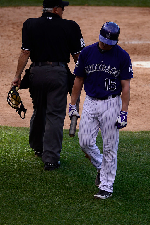 . Jordan Pacheco (15) of the Colorado Rockies reacts to getting struck out against the Los Angeles Dodgers during the Dodgers\' 10-8 win in Denver on Monday, September 2, 2013. The Colorado Rockies hosted the Los Angeles Dodgers at Coors Field. (Photo by AAron Ontiveroz/The Denver Post)