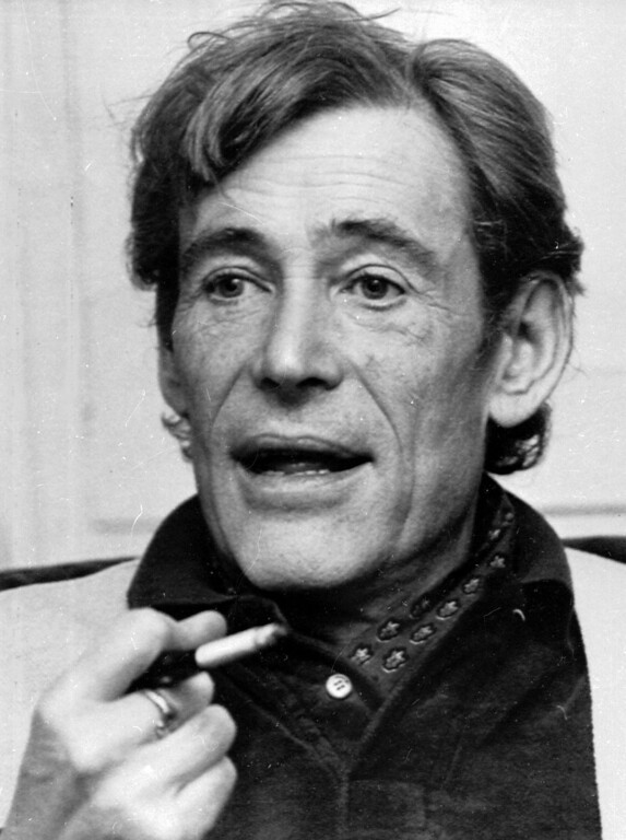 . Actor Peter O\'Toole smokes during an interview at his London home on Dec. 23, 1980. O\'Toole, the charismatic actor who achieved instant stardom as Lawrence of Arabia and was nominated eight times for an Academy Award, has died. He was 81. O\'Toole\'s agent Steve Kenis says the actor died Saturday, Dec. 14, 2013 at a hospital following a long illness. (AP Photo/Dave Caulkin, file)