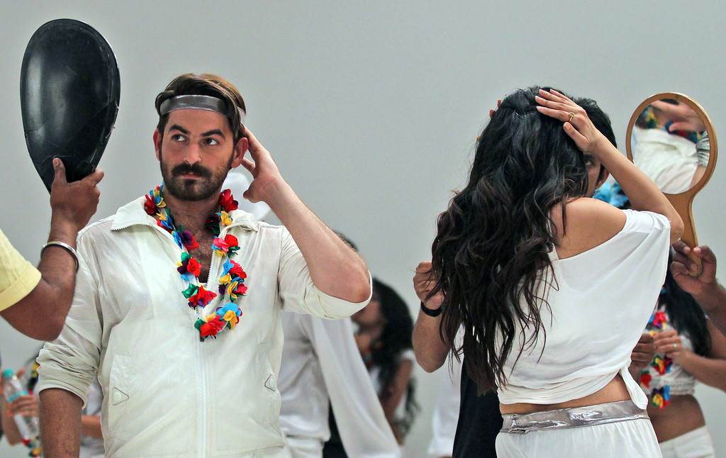 ". In this April 21, 2013 photograph, Indian Bollywood actors Neil Nitin Mukesh, left, and Puja Gupta, back to camera check their make up while shooting their upcoming film ìShortcut Romeoî in Mumbai, India.  Friday, May 3 marks exactly a hundred years after India\'s first feature film ""Raja Harischandra,\""  a silent movie, was screened in 1913. India produced almost 1,500 movies last year and the industry is expected to grow from $2 billion to $3.6 billion in the next five years, according to consultancy KPMG. (AP Photo/Rafiq Maqbool)"