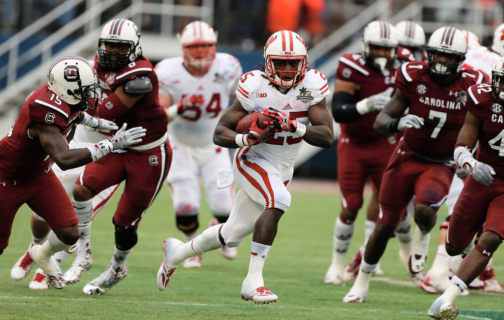 . Melvin Gordon #25 of the Wisconsin Badgers runs for a big gain in the first half against the South Carolina Gamecocks during the Capital One Bowl on January 1, 2014 in Orlando, Florida.  (Photo by Scott Halleran/Getty Images)