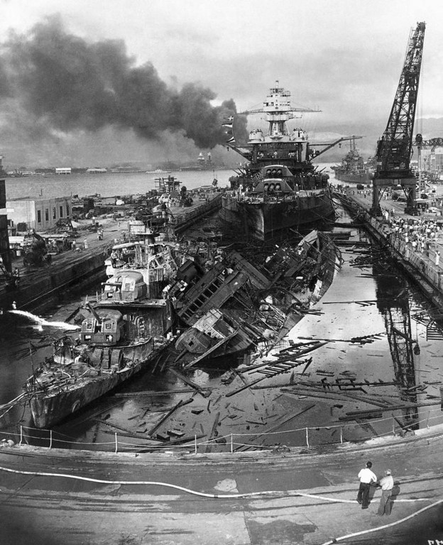 . In this image provided by the U.S. Department of Defense, destroyers in drydock at Pearl Harbor in Hawaii are battered by bombs after Japanese sneak attack on Dec. 7, 1941. Background in dock is battleship Pennsylvania, which suffered only minor damage. Destroyers are Downes, left, and Cassin, right. Machinery and fittings were transferred to new hulls and the destroyers were never stricken from Navy\'s active list. (AP Photo/U.S. Department of Defense)