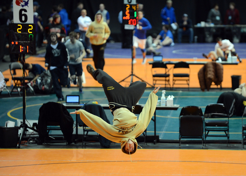 . DENVER, CO. - FEBRUARY 22: Dalton Gregory of Pagosa Springs High School flips during his warming up for 138 pound class preliminary match of 3A High School State Championship at Pepsi Center February 22, 2013. Denver, Colorado. (Photo By Hyoung Chang/The Denver Post)