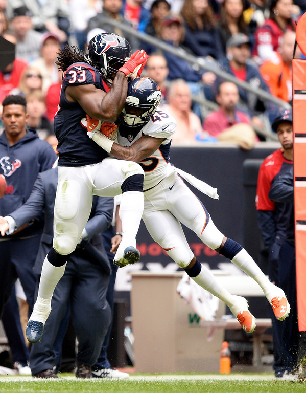 . HOUSTON, TX - DECEMBER 22: Denver Broncos cornerback Dominique Rodgers-Cromartie (45) puts a hit on Houston Texans fullback Greg Jones (33) after missing a pass during the second quarter December 22, 2013 at Reliant Stadium. Dominique Rodgers-Cromartie was penalized on the play for hitting a defensive player.  (Photo by John Leyba/The Denver Post)