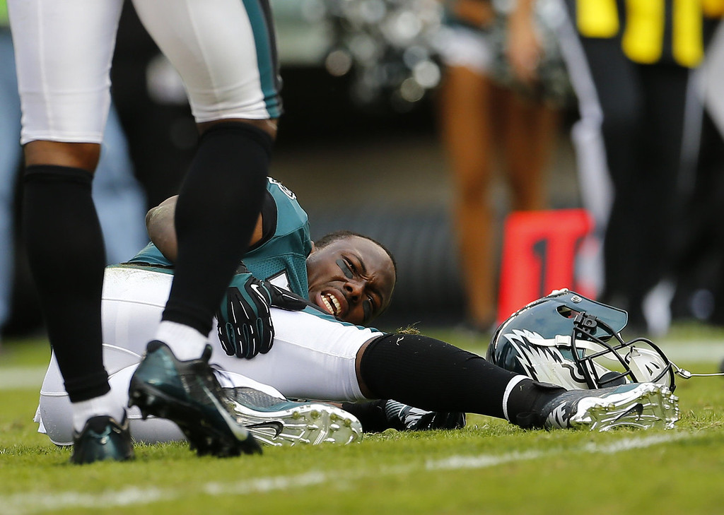 . Running back LeSean McCoy #25 of the Philadelphia Eagles holds his leg in pain after being tackled against the Washington Redskins in the second quarter during a game at Lincoln Financial Field on November 17, 2013 in Philadelphia, Pennsylvania. (Photo by Rich Schultz /Getty Images)