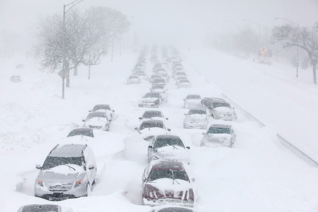 . In this Feb. 2, 2011 file photo, hundreds of cars are seen stranded on Lake Shore Drive in Chicago. Global warming is rapidly turning America the beautiful into America the stormy, sneezy and dangerous,  according to a new U.S. federal scientific report released Tuesday, May 6, 2014. (AP Photo/Kiichiro Sato)