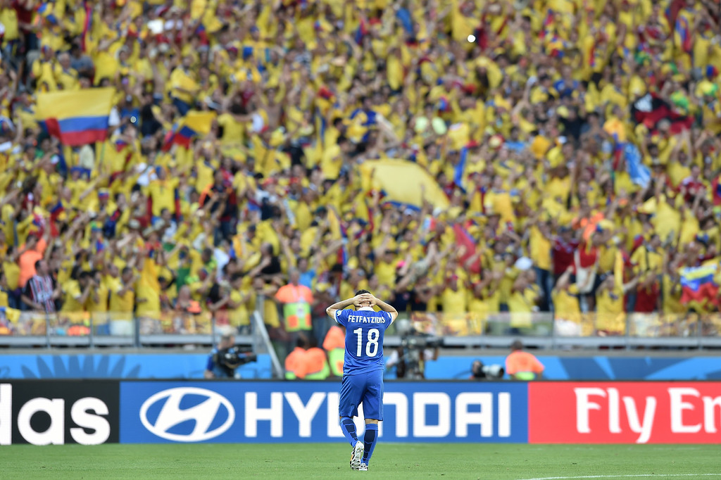 . Greece\'s forward Ioannis Fetfatzidis gestures after a 0-3 defeat during a group C football match between Colombia and Greece at the Mineirao Arena in Belo Horizonte during the 2014 FIFA World Cup on June 14, 2014.  AFP PHOTO / ARIS MESSINIS