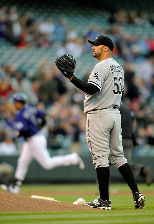 . Chicago White Sox starting pitcher Felipe Paulino stands in the infield as Colorado Rockies Carlos Gonzalez rounds the bases after hitting a home run in the first inning of a baseball game on Monday, April 7, 2014, in Denver.(AP Photo/Chris Schneider)