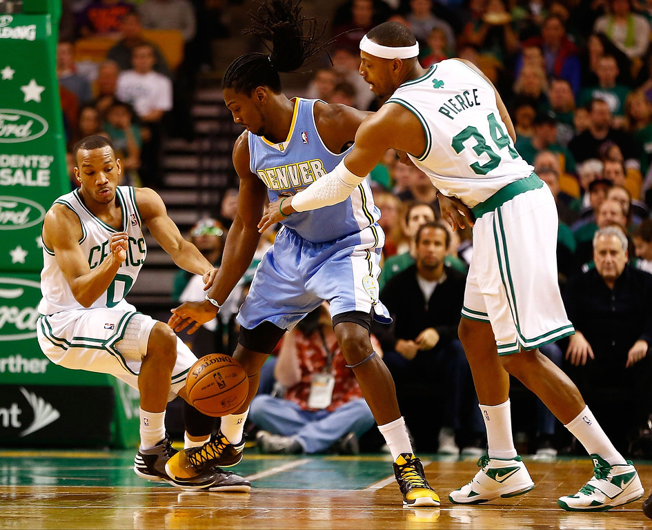 . BOSTON, MA - FEBRUARY 10: Kenneth Faried #35 of the Denver Nuggets loses the ball in front of Paul Pierce #34 and Avery Bradley #0 of the Boston Celtics during the game on February 10, 2013 at TD Garden in Boston, Massachusetts.  (Photo by Jared Wickerham/Getty Images)
