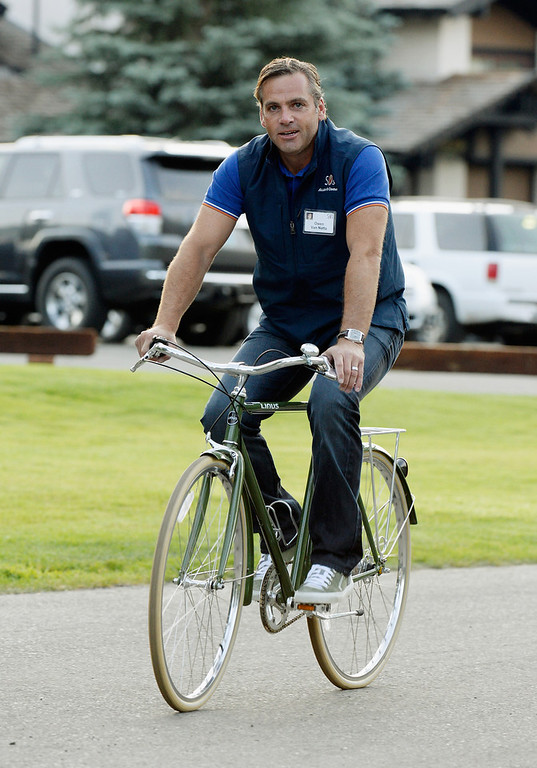 . Owen Van Natta, former Executive Vice President of Business at Zynga arrives by bicycle for the Allen & Co. annual conference at the Sun Valley Resort on July 10, 2013 in Sun Valley, Idaho. The resort is hosting corporate leaders for the 31st annual Allen & Co. media and technology conference where some of the wealthiest and most powerful executives in media, finance, politics and tech gather for weeklong meetings. Past attendees included Warren Buffett, Bill Gates and Mark Zuckerberg.  (Photo by Kevork Djansezian/Getty Images)