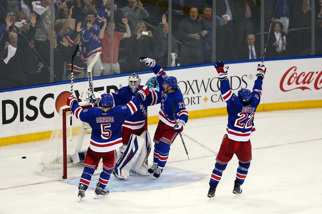 . Henrik Lundqvist #30 of the New York Rangers celebrates with his teammates after defeating the Montreal Canadiens in Game Six of the Eastern Conference Final in the 2014 NHL Stanley Cup Playoffs at Madison Square Garden on May 29, 2014 in New York City. The New York Rangers defeated the Montreal Canadiens 1 to 0.  (Photo by Elsa/Getty Images)