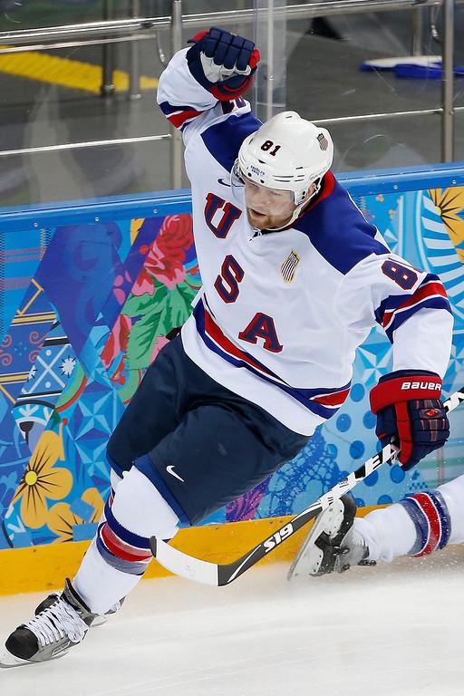 . USA forward Phil Kessel celebrates his goal against Slovenia during the 2014 Winter Olympics men\'s ice hockey game at Shayba Arena Sunday, Feb. 16, 2014, in Sochi, Russia. (AP Photo/Petr David Josek)